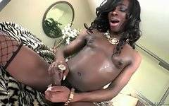 Sweet ebony she-male masturbates until sprays her load of cum.